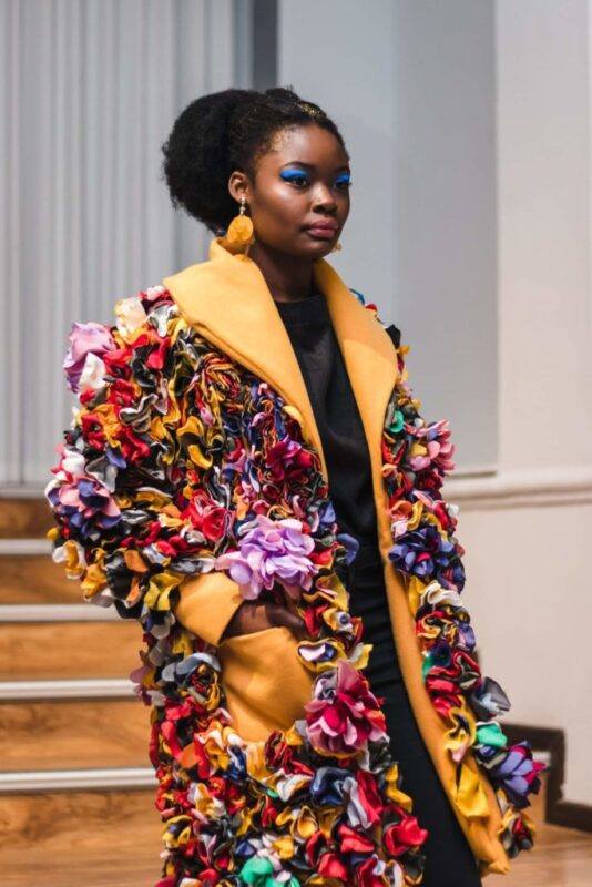 Dorcas Mutombo made 1066 scrap fabric flowers for her statement jacket