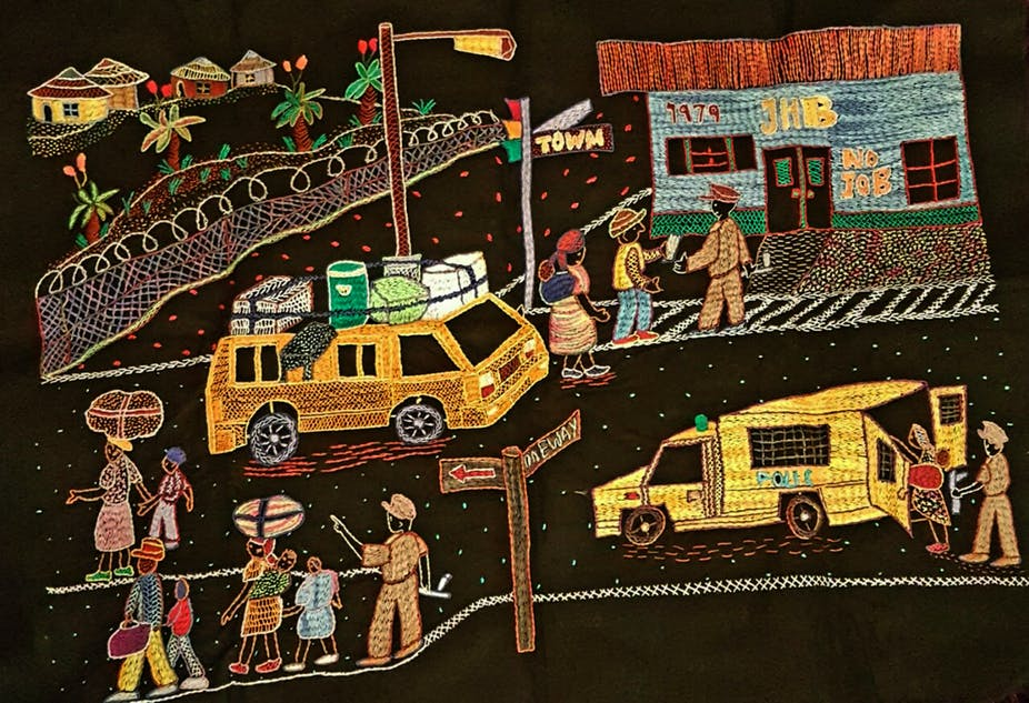 Embroidery depicting an urban scene including police.